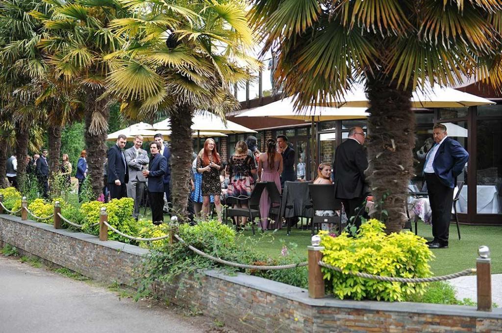 Frensham-ponds-hotel-wedding-guests-on-lawn.jpg